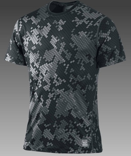 9c8f6b439 The Nike Pro Combat Core Fitted Camouflage Men's Shirt features a digital  camouflage pattern in a color described as 'Black/Flint Grey'.
