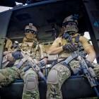 Shooters in chopper door.