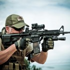 Shooter with Mission First Tactical gear on rifle
