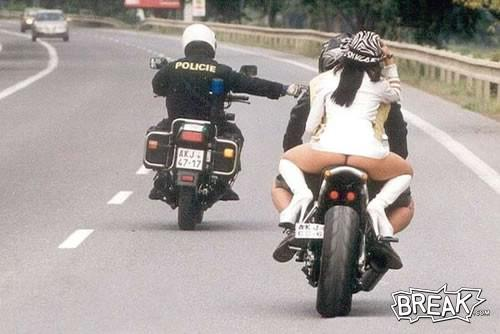Motorcycle cop pulls over another motorcyle with hot biker chick on the back.