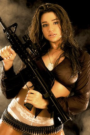 Hot chicks with guns: busty brunette with carbine.